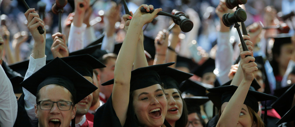 Graduating Law School students cheer as they receive their degrees during the 365th Commencement Exercises at Harvard University in Cambridge, Massachusetts, U.S. May 26, 2016.  REUTERS/Brian Snyder - S1BETGHJWQAA