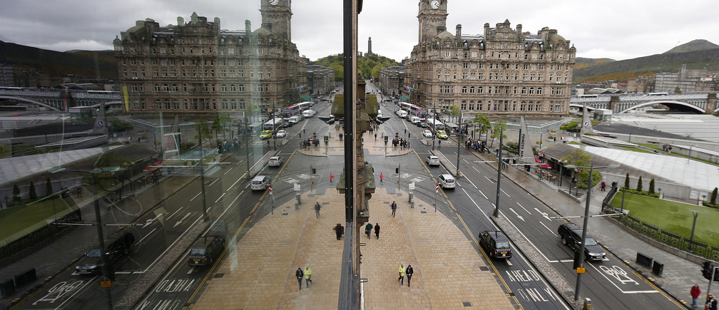 Pedestrians walk along Princes Street, the main shopping street in Edinburgh, Scotland May 1, 2014.
