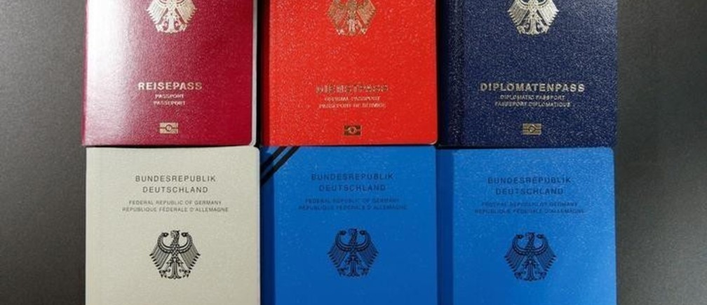 Specimens of German new electronic passports are pictured during a presentation to the media in Berlin, Germany, February 23, 2017.     REUTERS/Fabrizio Bensch