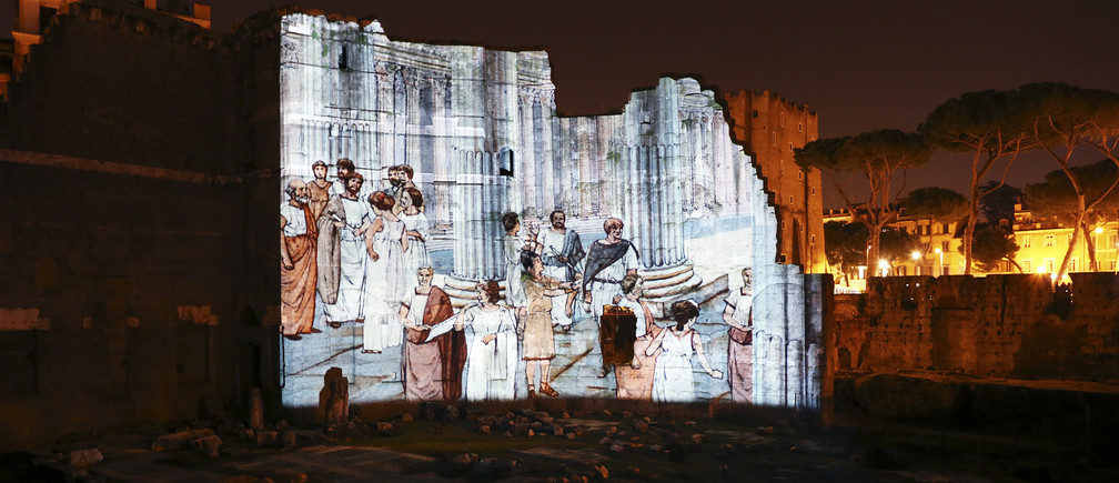 "A projection shows life as it probably was 2,000 years ago in the Forum of Augustus in ancient Rome April 21, 2014.  Rome, a city that thinks in millennia, is going through a bout of ""Augustus fever"" to mark the 2,000th anniversary of the death of its first emperor, who left his mark on Rome and Western civilisation like few others. The Eternal City is staging shows, exhibitions, debates and seminars on Augustus, who died on August 19, 14 AD at the age of 75 after a 41-year reign that was the longest in Roman history. Picture taken April 21, 2014.   REUTERS/Alessandro Bianchi (ITALY - Tags: SOCIETY ANNIVERSARY) - GM1EA4U1BG501"
