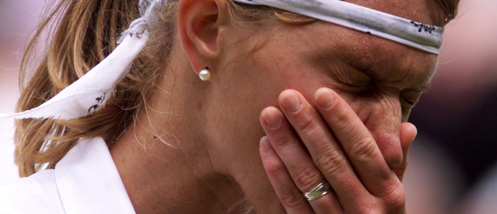 Germany's Steffi Graf sneezes during her match against Lindsay Davenport of the U.S. in the final of the Ladies' Singles competition at the Wimbledon Tennis Championships July 4. Graf is seed number two in the tournament.JB/AS - RP1DRILDHIAC