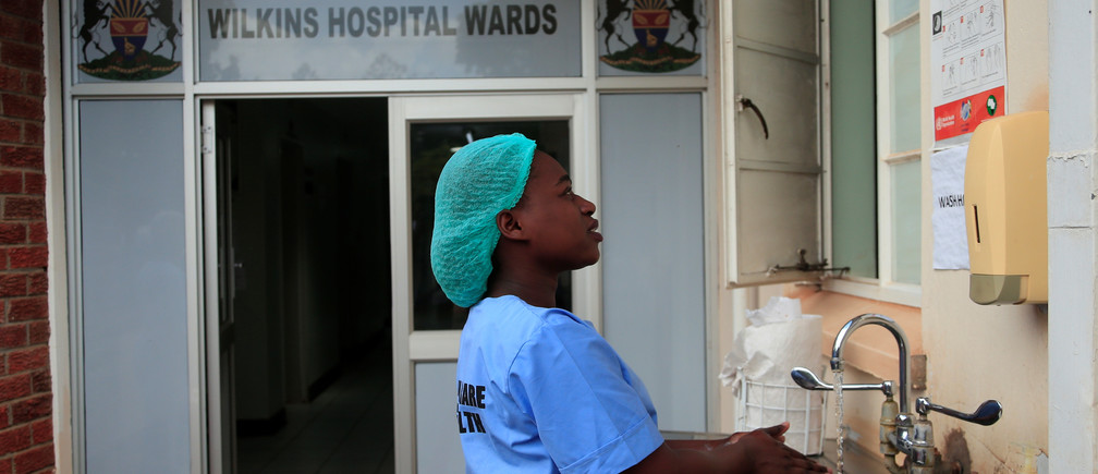A health worker washes her hands during a demonstration of preparations for any potential coronavirus cases at a hospital in Harare, Zimbabwe, March 11, 2020. Picture taken March 11, 2020. REUTERS/Philimon Bulawayo - RC20IF98P1HL
