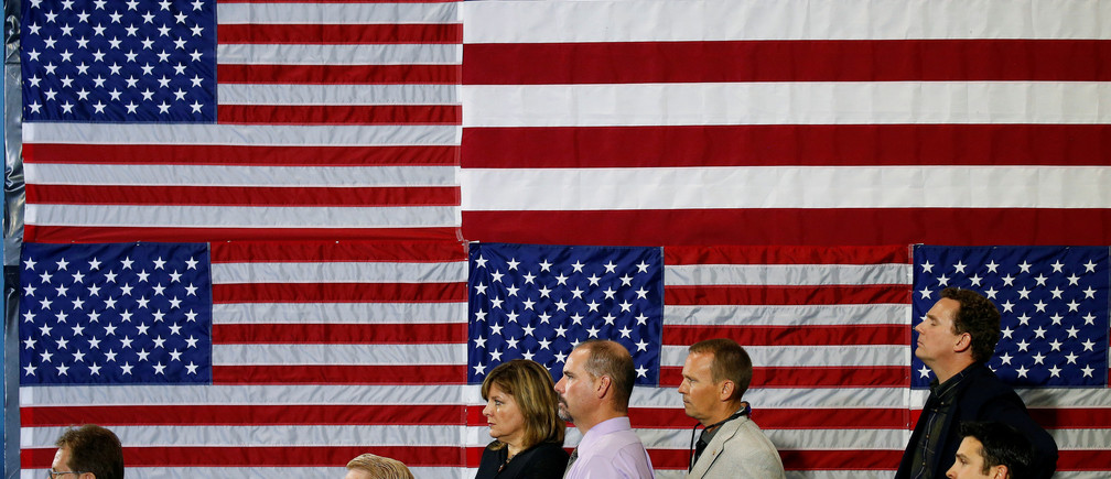 People listen as U.S. President Donald Trump speaks about tax reform in Harrisburg, Pennsylvania, U.S., October 11, 2017.   REUTERS/Joshua Roberts     TPX IMAGES OF THE DAY - RC128237A400