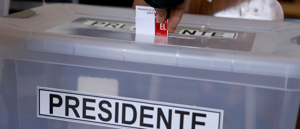 A citizen casts his ballot at a polling station in Chile