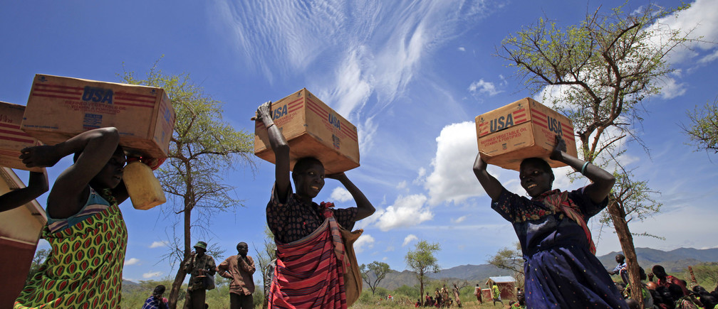 Women from Dadinga tribe carry boxes of oil during food distribution by World Food Program (WFP) in the village of Lauro, Budy county, in Eastern Equatoria State, south Sudan, April 3, 2010.   REUTERS/Goran Tomasevic  (SUDAN - Tags: SOCIETY POLITICS FOOD) - GM1E6431T2D01