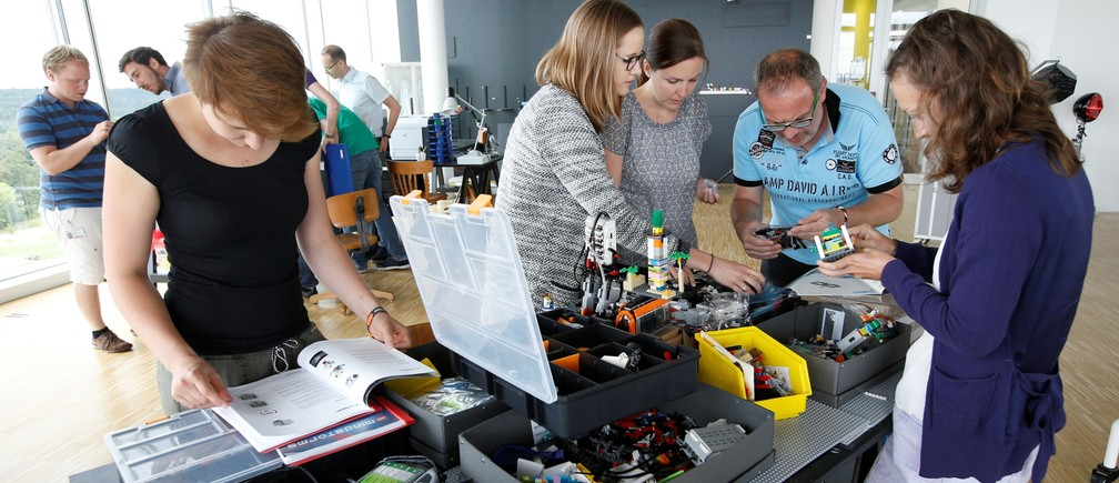 People work together in the creative zone of the Bosch research and advance development centre Campus in Renningen near Stuttgart, Germany July 29, 2016.