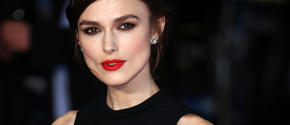 "Actress Keira Knightley poses for photos at the European Premiere of ""Jack Ryan: Shadow Recruit"" in Leicester Square, central London January 20, 2014. REUTERS/Andrew Winning  (BRITAIN - Tags: ENTERTAINMENT) - GM1EA1L07NP01"