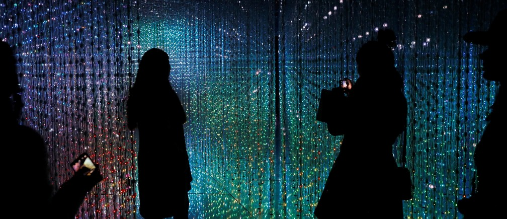 "Visitors look at a digital installation which is a part of ""Dance! Art Exhibition, Learn & Play!"" by Japanese group teamLab in Taipei, Taiwan January 16, 2017."