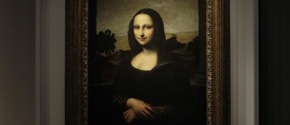 """The portrait of Mona Lisa is pictured on a painting attributed to Leonardo da Vinci during a presentation in Geneva September 27, 2012. A package of diaries said to have been posted to the United States from Britain in the 1960s could provide a vital clue to the origin of a controversial portrait presented in Geneva last month as Leonardo da Vinci's original """"Mona Lisa."""" Picture taken September 27, 2012.    REUTERS/Denis Balibouse   (SWITZERLAND - Tags: SOCIETY)"""