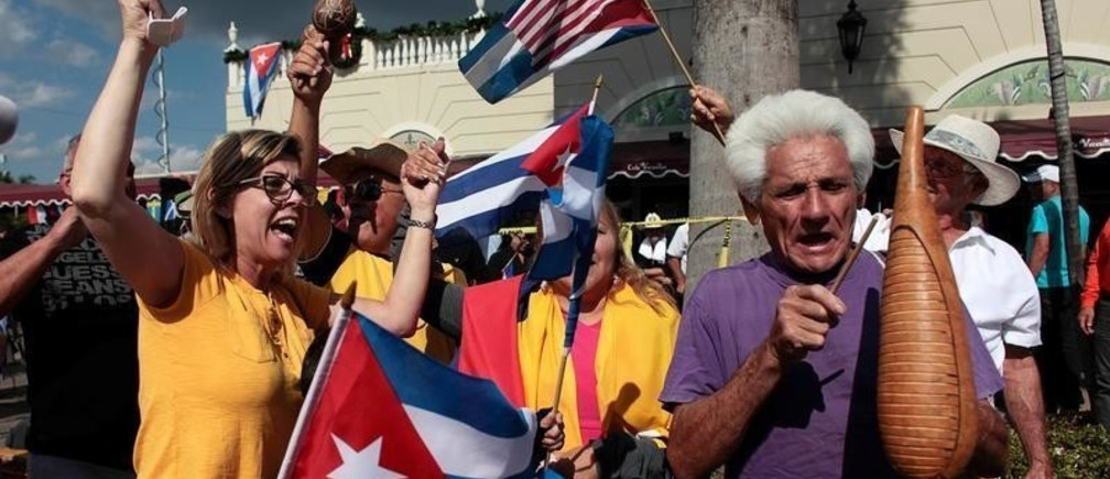 People celebrate a day after the announcement of the death of Cuban revolutionary leader Fidel Castro in the Little Havana district of Miami, Florida, U.S. November 27, 2016.