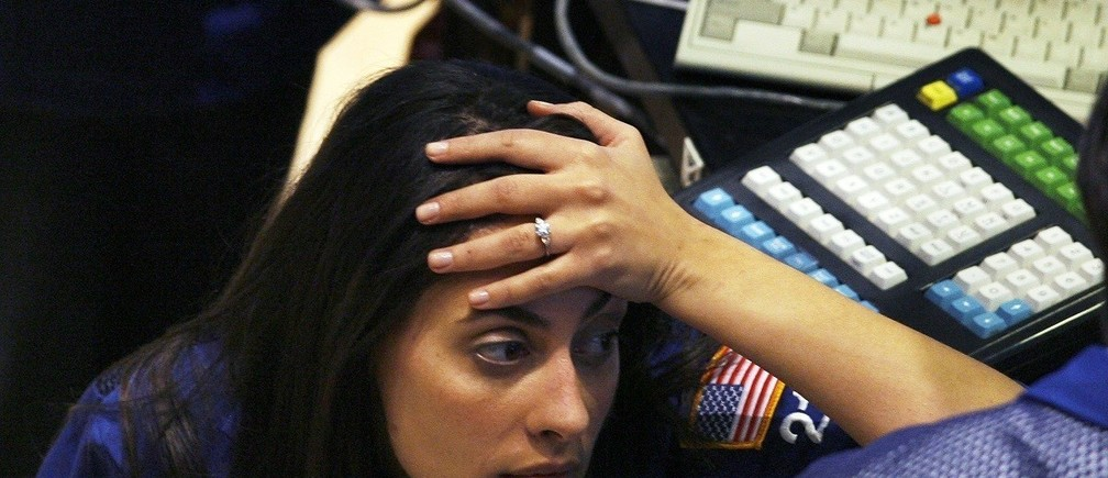 A trader reacts after the closing bell of the New York Stock Exchange on November 5, 2008. U.S. stocks plummeted on Wednesday, a day after Barack Obama's historic victory in the U.S. presidential election, as a fresh batch of dismal economic data underscored the massive challenges awaiting his administration.  REUTERS/Lucas Jackson (UNITED STATES) - RTXAAW0