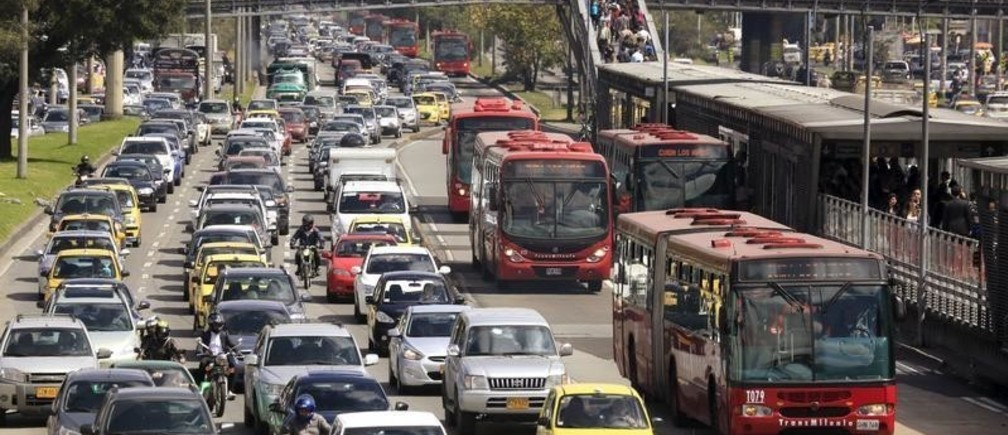 Cars and public buses are seen in a traffic jam along a main street ahead of local elections in Bogota, October 20, 2015. The local elections in Colombia will be held on Sunday October 25 amid outrage over chaotic transport, increased insecurity, dirty streets and corruption in the capital. Picture taken on October 20, 2015. REUTERS/Jose Miguel Gomez - GF20000028264