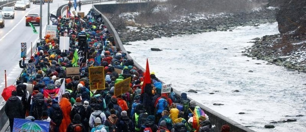 Climate activists take part in a march to highlight issues surrounding climate change at the World Economic Forum Davos (WEF), through the Chlus gorge along the Landquart river near Landquart, Switzerland January 19, 2020. REUTERS/Arnd Wiegmann - RC23JE97M6YM