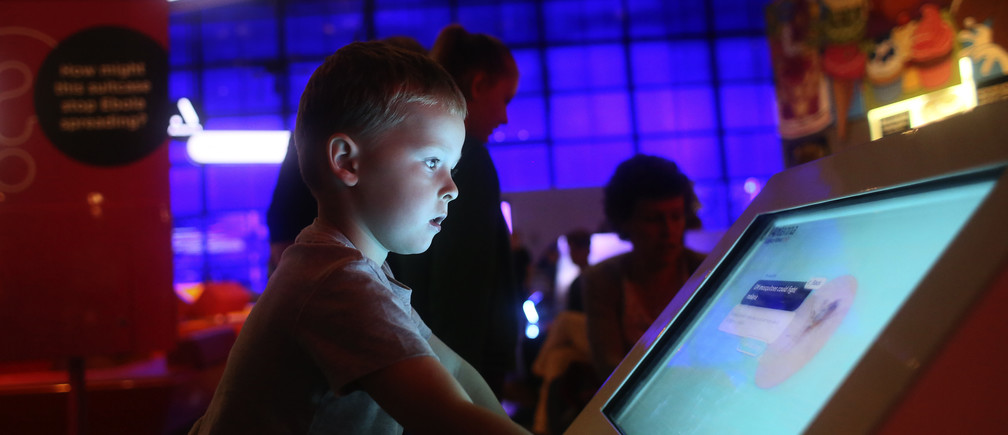 Alfie Latimer (4) from Dubai looks at an exhibit in the Science Museum, London August 4, 2015.