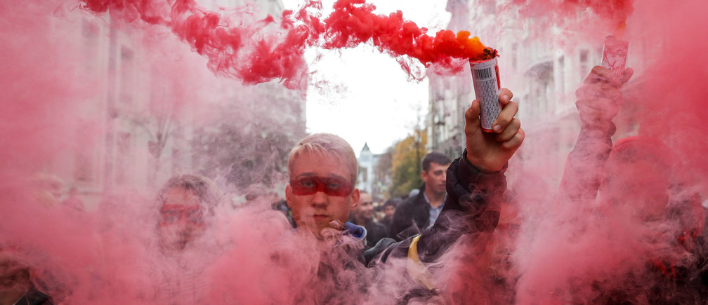 People burn flares during a rally against the approval of the so-called Steinmeier Formula, in Kiev, Ukraine October 6, 2019. REUTERS/Valentyn Ogirenko     TPX IMAGES OF THE DAY - RC1262729CC0