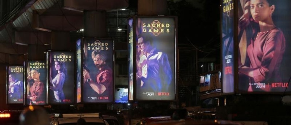 """Traffic moves on a road past hoardings of Netflix's new television series """"Sacred Games"""" in Mumbai, India, July 11,  2018. Picture taken July 11, 2018. REUTERS/Francis Mascarenhas - RC158AE0F180"""