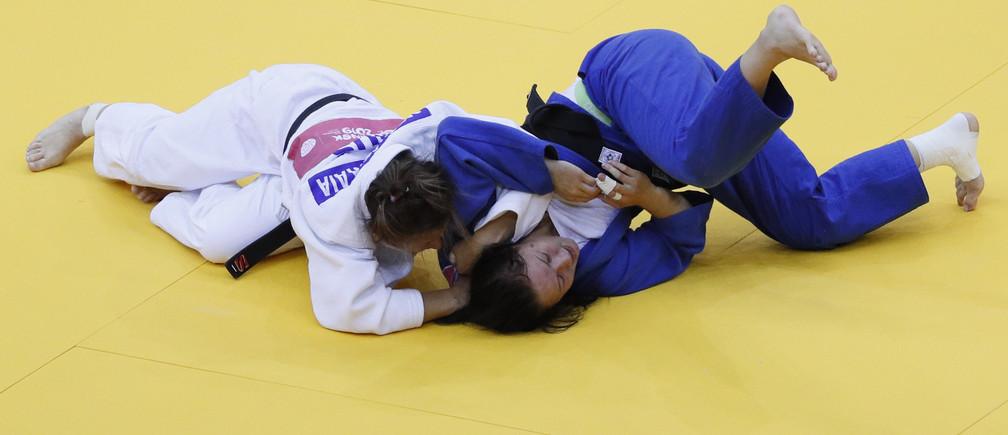2019 European Games - Judo - Mixed Team - Women's -57kg - Chizhovka Arena, Minsk, Belarus - June 25, 2019.  Belarus' Ulyana Minenkova in action with Russian Federation's Daria Mezhetskaia during the semi finals REUTERS/Valentyn Ogirenko - UP1EF6P0YW28Y