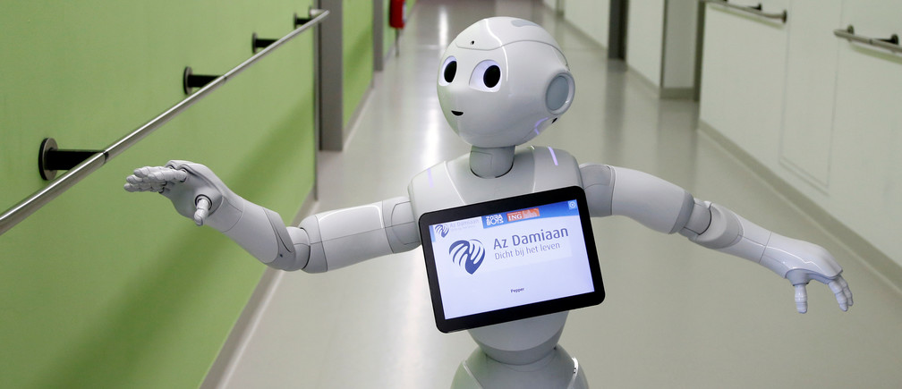 """New recruit """"Pepper"""" the robot, a humanoid robot designed to welcome and take care of visitors and patients, is seen at AZ Damiaan hospital in Ostend, Belgium June 16, 2016. REUTERS/Francois Lenoir  - D1AETKGAYPAB"""