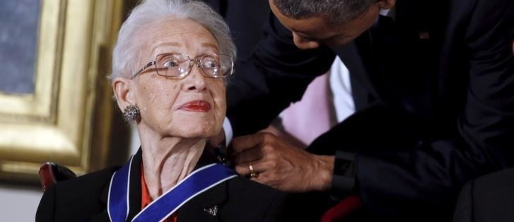 U.S. President Barack Obama presents the Presidential Medal of Freedom to NASA mathematician Katherine G. Johnson during an event in the East Room of the White House in Washington November 24, 2015. Johnson is a pioneer in American space history. REUTERS/Carlos Barria