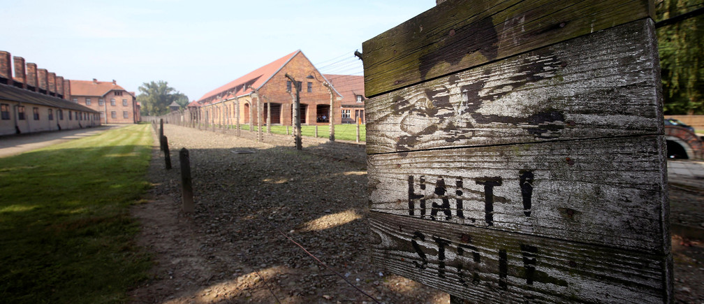 "A sign reading "" Halt, Stop"" is seen at the  Auschwitz's former Nazi death camp, during a visit of Pope Francis, Poland, July 29, 2016. REUTERS/Stefano Rellandini - RTSK7O5"