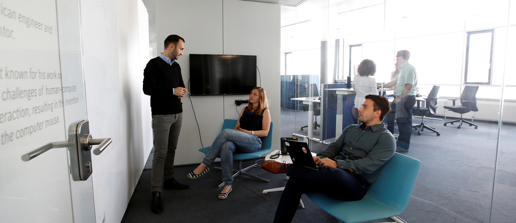 Employees sit together in a new designed workplace situation of a Bosch company building in Stuttgart-Feuerbach, Germany July 29, 2016. REUTERS/Michaela Rehle - D1BETTNFABAA