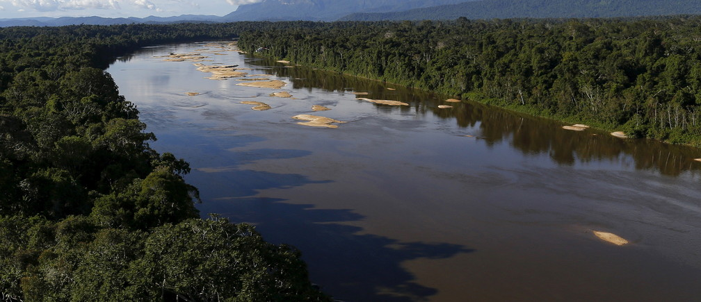 """Uraricoera River is seen during Brazil's environmental agency operation against illegal gold mining on indigenous land, in the heart of the Amazon rainforest, in Roraima state, Brazil April 15, 2016. At over 9.5 million hectares, the Yanomami territory is twice the size of Switzerland and home to around 27,000 indians. The land has legally belonged to the Yanomami since 1992, but illegal miners continue to plague the area, sawing down trees and poisoning rivers with mercury in their lust for gold. REUTERS/Bruno Kelly     SEARCH """"AMAZON GOLD"""" FOR THIS STORY. SEARCH """"THE WIDER IMAGE"""" FOR ALL STORIES - GF10000395306"""