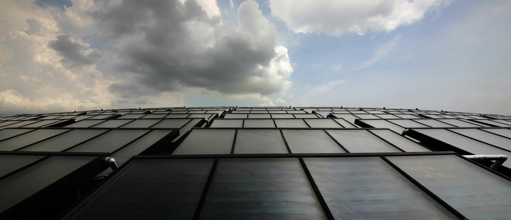 Solar thermal collectors are seen on the roof of a building at the United World College of South East Asia (UWCSEA) East Campus in Singapore December 7, 2011. The installation by Austrian firm SOLID GmbH is the world's largest solar thermal cooling plant, with the total installed capacity for cooling and heating of approximately 2,730 kWth, according to the company.REUTERS/Tim Chong (SINGAPORE - Tags: ENERGY EDUCATION BUSINESS SCIENCE TECHNOLOGY) - GM1E7C71APJ01