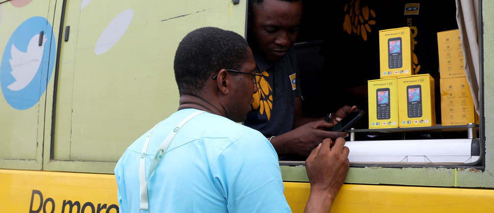 An MTN customer care staff attends to a client in an MTN service bus in Lagos, Nigeria August 28, 2019. Picture taken August 28, 2019. REUTERS/Temilade Adelaja - RC1AB3354300
