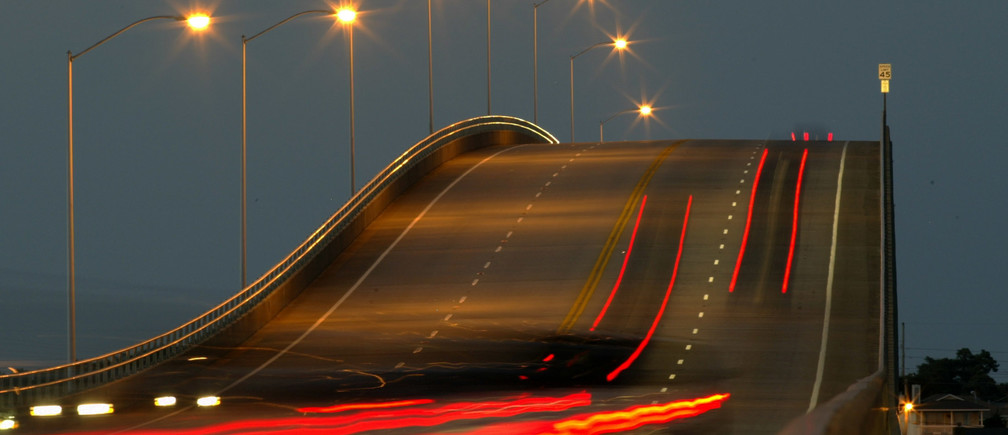 Taillights from vehicles are shown in a time exposure as motorists depart Atlantic Beach, North Carolina, which is located on a barrier island, September 16, 2003.