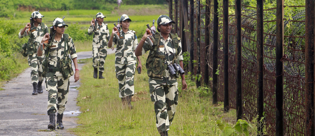 Female personnel of India's Border Security Force (BSF) patrol along the fencing of the India-Bangladesh international border ahead of India's Independence Day celebrations, at Dhanpur village in India's northeastern state of Tripura August 11, 2014. India commemorates its Independence Day on August women men female male girls boys teenagers teens development gender gap parity india indian equality diversity progress change femmine masuline woman man sex biology roles dynamic balance bias androgynous