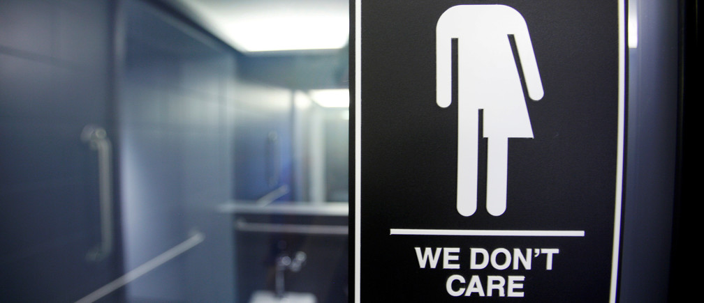 A sign protesting a recent North Carolina law restricting transgender bathroom access adorns the bathroom stalls at the 21C Museum Hotel in Durham, North Carolina May 3, 2016. REUTERS/Jonathan Drake/File Photo - RTX2RU1H