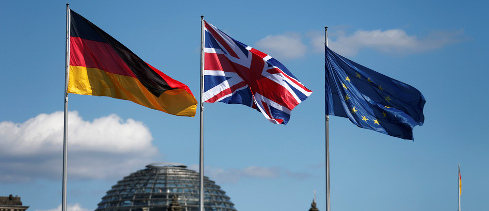 German, British and European Union flags fly in front of the Reichstag building in Berlin, Germany July 20, 2016.