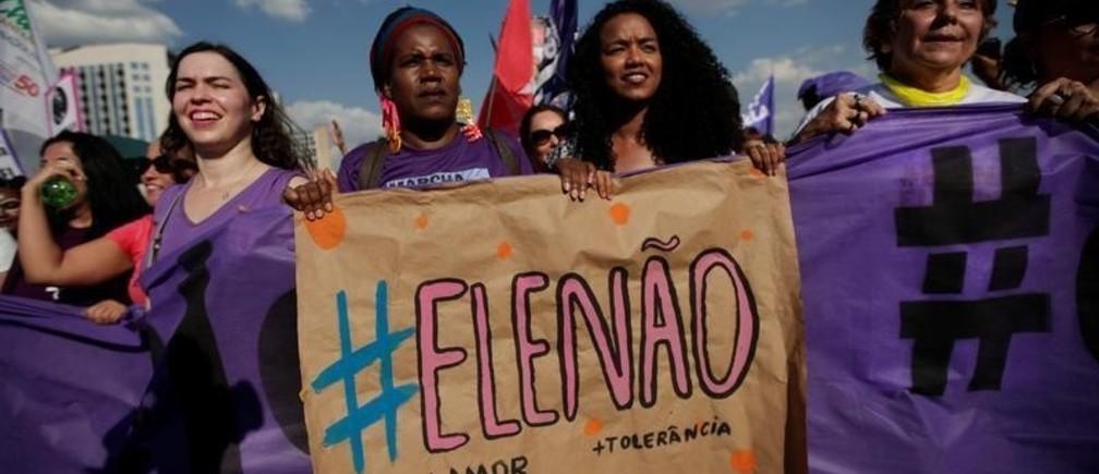 "Women holds a sign that reads ""Not Him"" during demonstrations against presidential candidate Jair Bolsonaro in Brasilia, Brazil September 29, 2018."