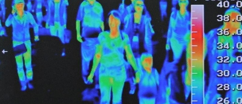 A thermal scanner shows the heat signature of passengers from an international flight arriving at Incheon airport, west of Seoul April 28, 2009. Airlines suffered an 11.1 percent fall in passenger numbers in March year-on-year, and swine flu stands to compound financial problems and suppress traffic even more, an industry body said on Tuesday.  REUTERS/Jung Yeon-je (SOUTH KOREA HEALTH TRANSPORT TRAVEL IMAGES OF THE DAY) - GM1E54S1AST01