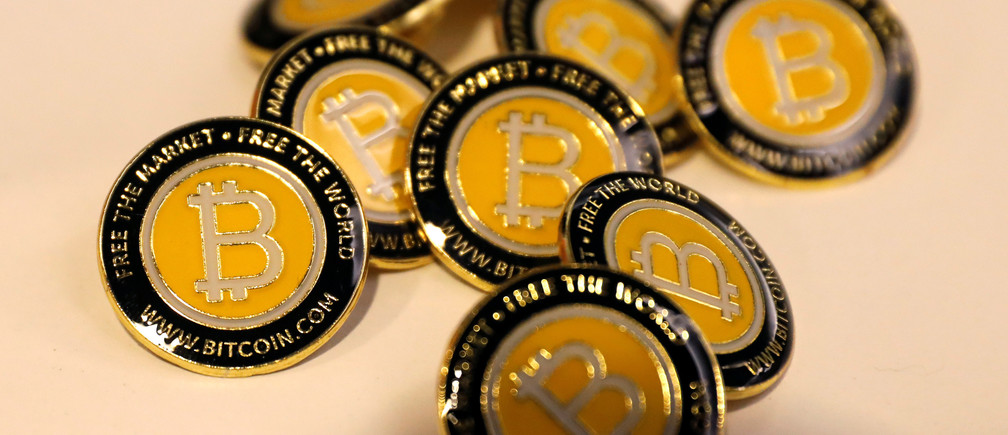 Bitcoin.com buttons are seen displayed on the floor of the Consensus 2018 blockchain technology conference in New York City, New York, U.S., May 16, 2018. REUTERS/Mike Segar - RC1B17B79620