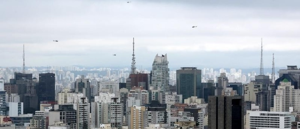 Helicopters belonging to the media fly over Paulista Avenue where people are protesting against Brazil's President Dilma Rousseff, as part of nationwide demonstrations calling for her impeachment, in Sao Paulo, Brazil, March 13, 2016.