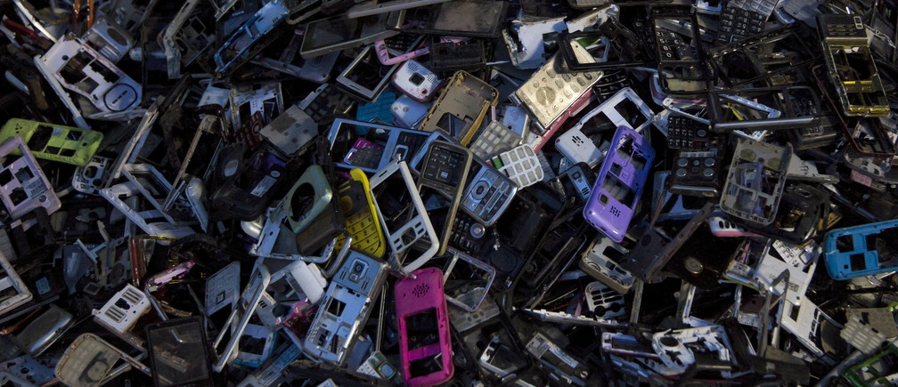 Old cellular phone components are discarded inside a workshop in the township of Guiyu in China's southern Guangdong province June 10, 2015.