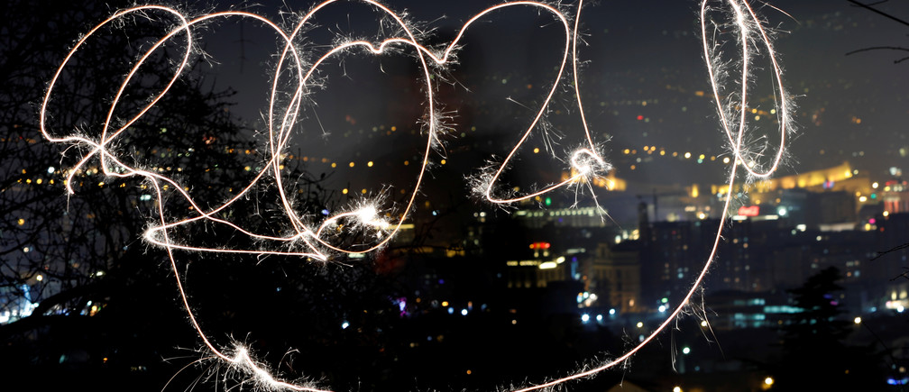 A girl with sparkle writes 2020 during New Year celebration , North Macedonia January 1, 2020. REUTERS/Ognen Teofilovski