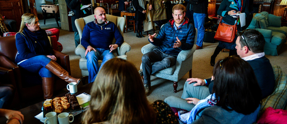 Prince Harry speaks with members of fellowship groups during a visit to a Help For Heroes Recovery Centre at Tedworth House, where he learnt more about the mental health support military veterans are receiving, in Tidworth, Wiltshire, Britain January 23, 2017. REUTERS/Ben Birchall/Pool - RC155C2DA170