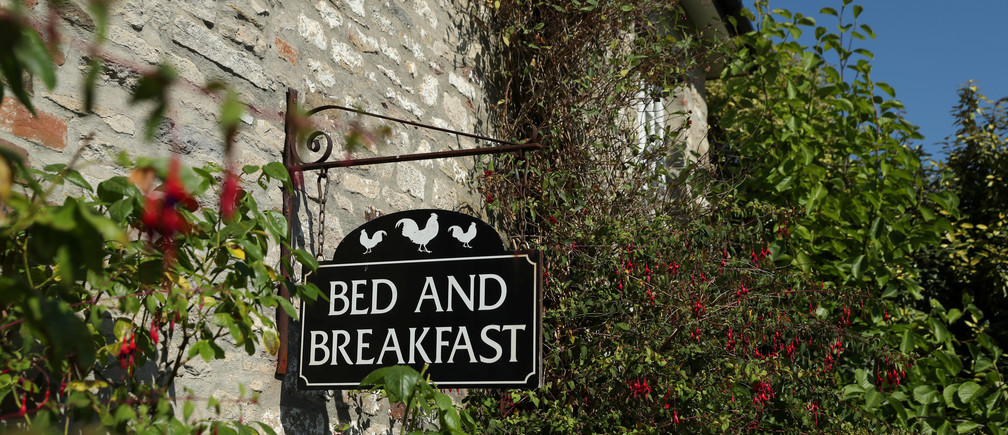 A bed and breakfast sign is seen at the Alford House in Corfe Castle, Britain, July 21, 2018. REUTERS/Peter Cziborra