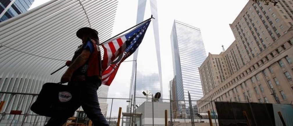 A man arrives at the World Trade Center complex on the morning of the 15th anniversary of the 9/11 attacks in Manhattan, New York, U.S., September 11, 2016.  REUTERS/Andrew Kelly