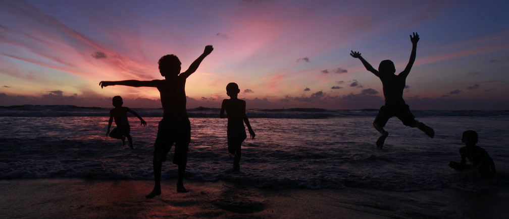 Children play at the Mount Lavinia beach in Colombo October 2 , 2011.