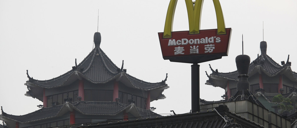 A McDonald's sign is displayed outside its outlet, the first one which opened in China in 1990, at the southern Chinese city of Shenzhen neighbouring Hong Kong March 18, 2013. McDonald's Corp gave away more than a million breakfast McMuffins across China on Monday, a few days after Chinese state television aired its annual expose on corporate malpractice to mark World Consumer Rights Day. The promotion, the U.S. fast food chain says, was purely coincidental.    REUTERS/Bobby Yip (CHINA - Tags: FOOD BUSINESS LOGO POLITICS SOCIETY) - RTR3F51T