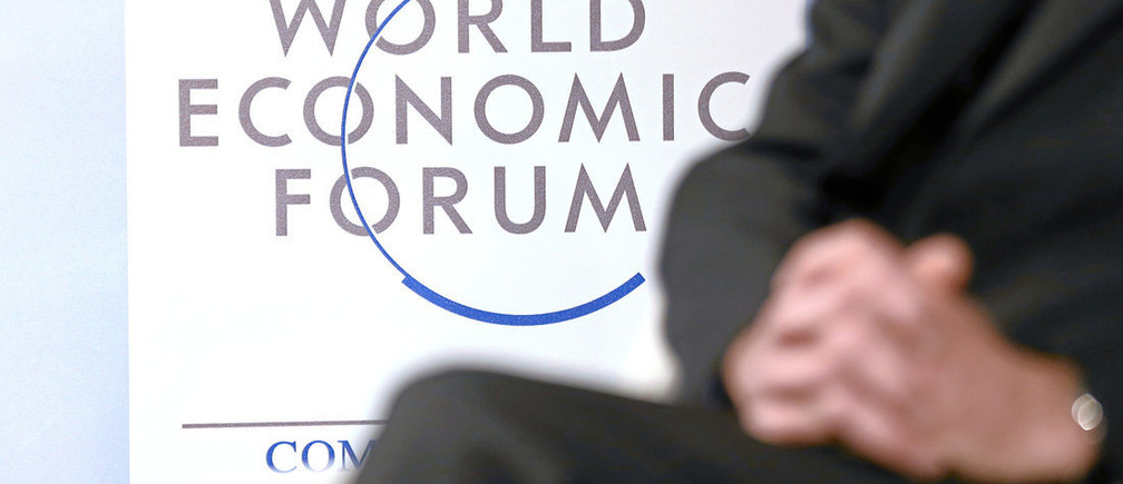 DAVOS/SWITZERLAND, 23JAN15 - Impression of the logo during the session 'The Human Brain: Deconstructing Mindfulness' at the Annual Meeting 2015 of the World Economic Forum at the congress centre in Davos, January 23, 2015. WORLD ECONOMIC FORUM/swiss-image.ch/Photo Valeriano DiDomenico