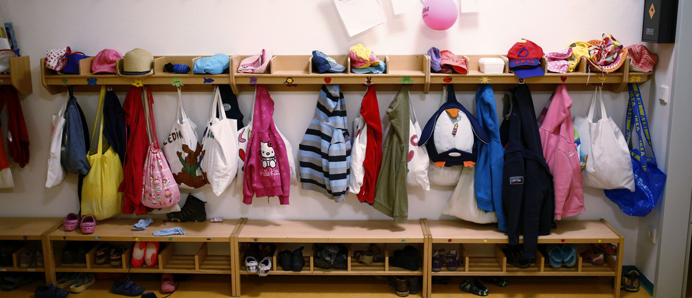 The wardrobe of one of four groups is seen inside the Kathinka-Platzhoff-Stiftung Kindergarten (Kathinka-Platzhoff-foundation kindergarden) in Hanau, 30km (18 miles) south of Frankfurt, July 16, 2013. From August 1, 2013, all children in Germany between the age of 1 and 3 will have a legal entitlement to a place at a kindergarten. The Kindergarten of the Kathinka-Platzhoff-Stiftung is one of few which hosts children between the age of six month and six years.  Picture taken July 16. REUTERS/Kai Pfaffenbach (GERMANY - Tags: POLITICS BUSINESS EMPLOYMENT SOCIETY EDUCATION) - BM2E97G13UD01