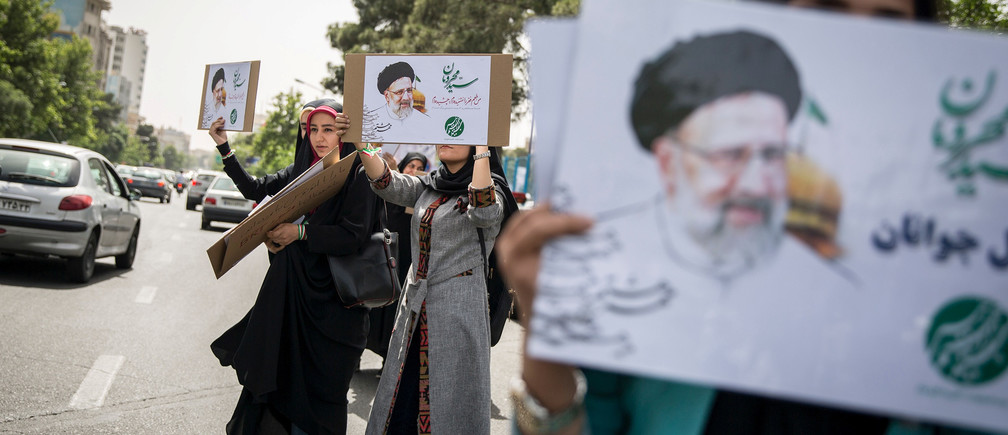 Supporters of Iranian Presidential candidate Ebrahim Raisi hold his posters outside the Mosalla mosque in Tehran, Iran, May 16, 2017. REUTERS/TIMA ATTENTION EDITORS - THIS IMAGE WAS PROVIDED BY A THIRD PARTY. FOR EDITORIAL USE ONLY. - RTX363Q8
