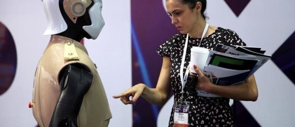A visitor looks at an operational robot policeman at the opening of the 4th Gulf Information Security Expo and Conference (GISEC) in Dubai, United Arab Emirates, May 22, 2017. REUTERS/Stringer