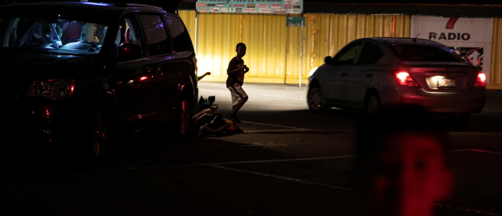 People leave after watching a movie at a drive-in theatre while keeping social distancing following the outbreak of the coronavirus disease (COVID-19) in Fort Lauderdale, Florida, U.S., March 28, 2020.