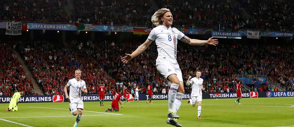 Football Soccer - Portugal v Iceland - EURO 2016 - Group F - Stade Geoffroy-Guichard, Saint-ƒtienne, France - 14/6/16 Iceland's Birkir Bjarnason celebrates after scoring their first goal.