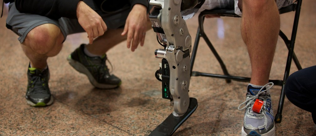 Zac Vawter, a 31-year-old software engineer from Seattle, Washington, prepares to climb to the 103rd story of the Willis Tower using the world's first neural-controlled Bionic leg in Chicago, November 4, 2012.